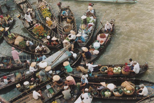 Chợ nổi Ngã Bảy, nét duyên của cô gái miệt vườn sông nước. Ảnh:Saigonstartravel.