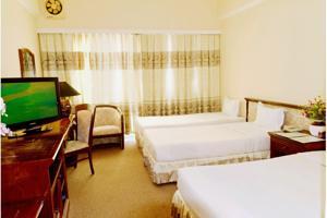 Giường Đơn trong Phòng ngủ Tập thể cho cả Nam và Nữ