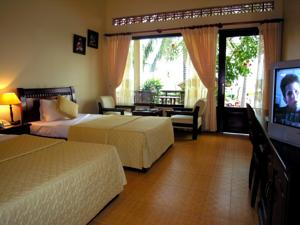 Phòng Deluxe đôi hay 2 giường đơn - Nằm trên Bãi biển